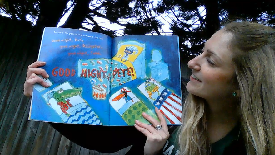 "Photo of a blonde woman looking at the inner pages of a ""Pete the Cat"" book"