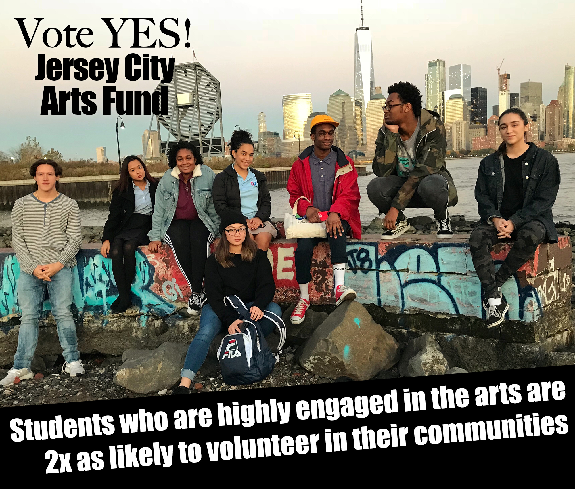 "A group of eight ethnically diverse high school-aged students are smiling at the camera with a city skyline behind them. The words ""Vote yes! Jersey City Arts Fund"" and ""Students who are highly engaged in the arts are 2x as likely to volunteer in their communities"" are seen on the image in white letting."